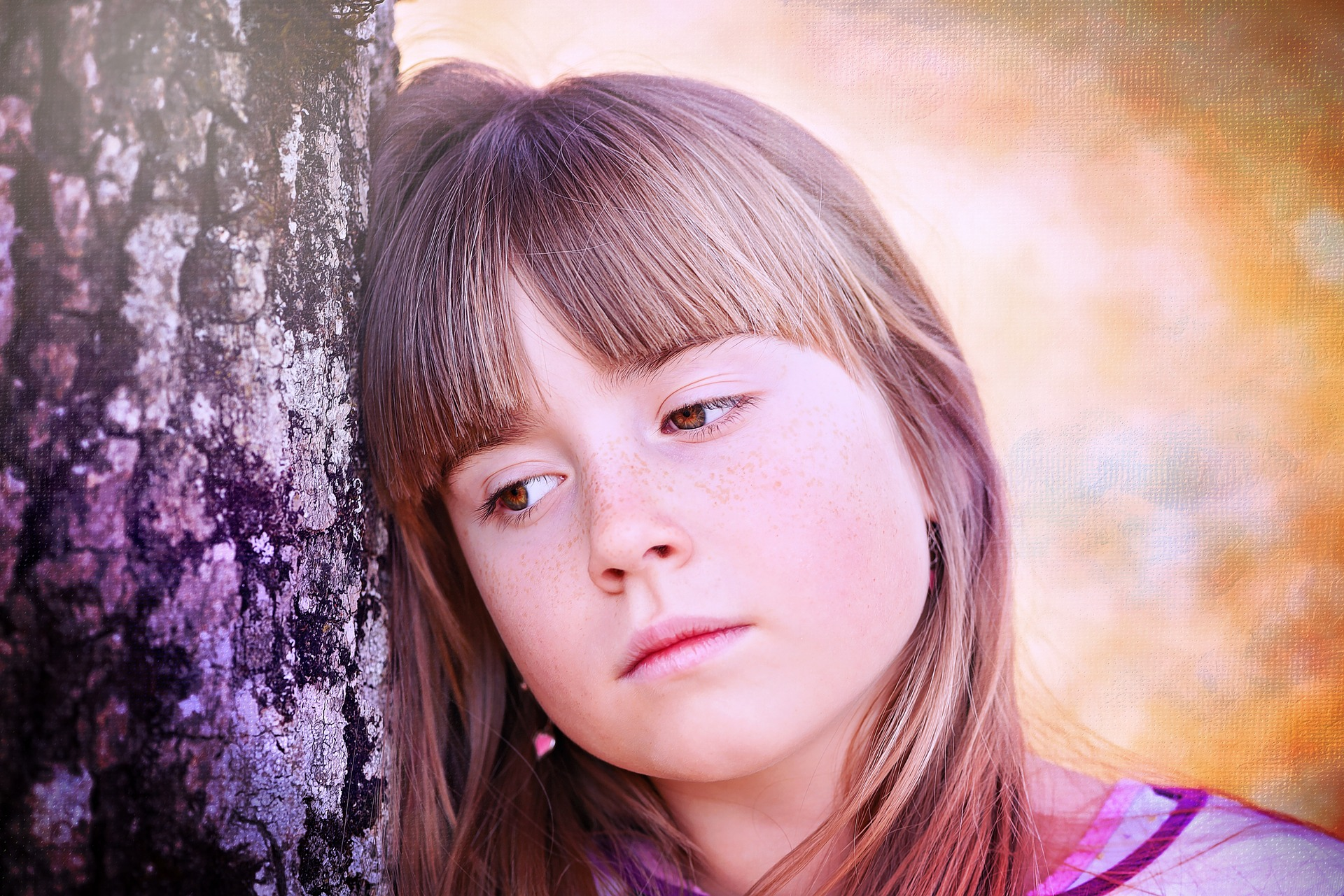 Young girl sad on tree
