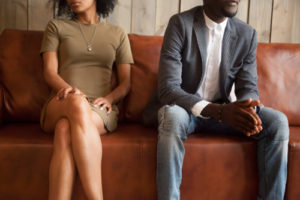 divorcing couple on couch